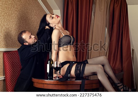 man holding a sensual woman by the hair - stock photo