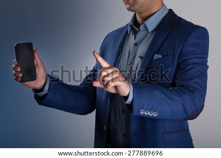 man holding a smartphone - stock photo