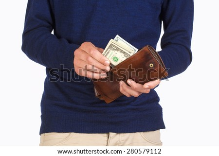 Man Holding a Wallet and Counting Dollar Bills - stock photo