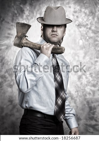 man holding axe on the shoulder
