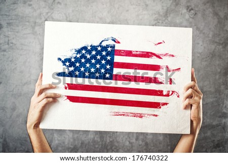 Man holding banner with USA Flag supporting national team, patriotism concept for 4th of July