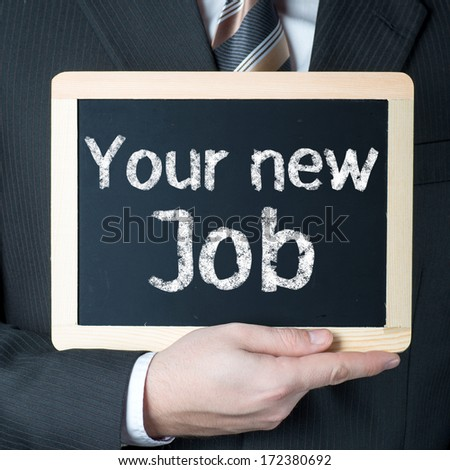 Man holding blackboard with words Your new Job  - stock photo