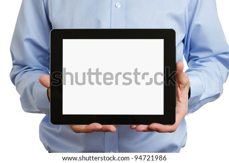 Man holding blank digital tablet with clipping path for the screen - stock photo