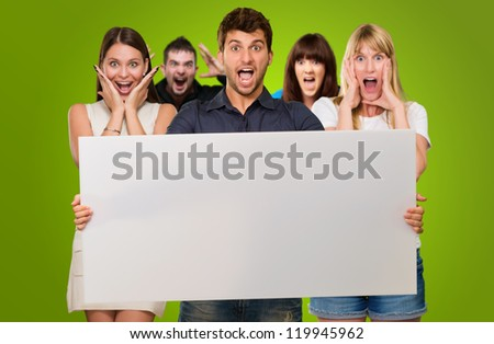 Man Holding Blank Placard And Woman Screaming From Behind On Green Background