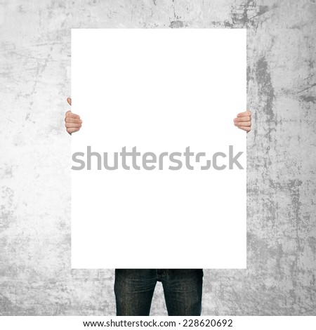 man holding blank poster on grunge background