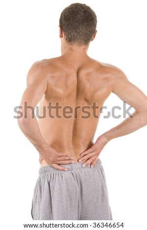 Man holding body like he is sore. - stock photo