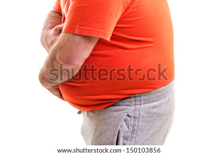 Man holding both hands on his aching stomach, closeup, over white background - stock photo