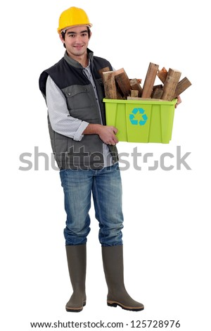 Man holding box of wood to be recycled