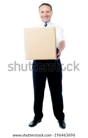 Man holding cardboard box on white background - stock photo