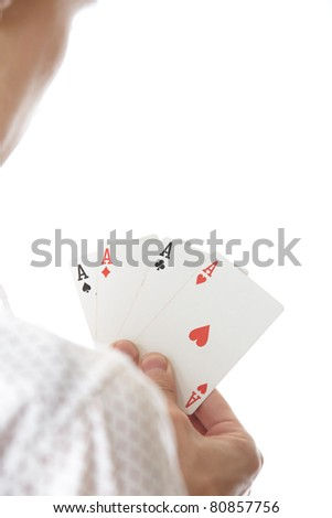Man holding cards with Four of Aces. Rear view on a white background. Focus is on cards - stock photo