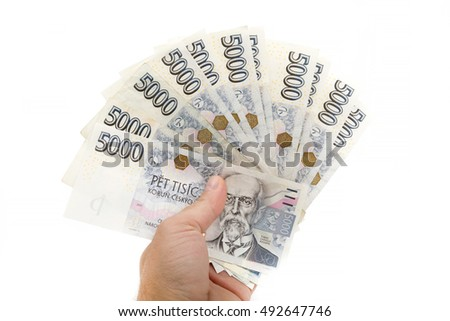 Man holding czech banknotes nominal value five thousand crowns isolated on white background.