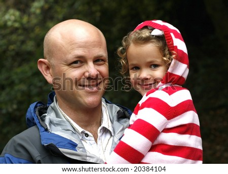 man holding daughter - stock photo