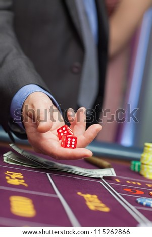 Man holding dice in his hands - stock photo