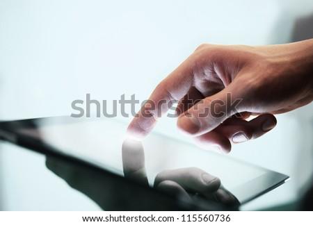 man holding digital tablet, closeup - stock photo