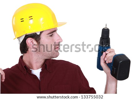 Man holding drill - stock photo