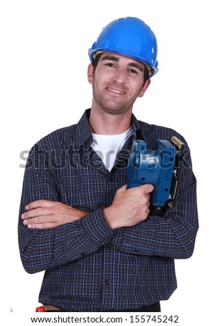 Man holding electric sander - stock photo