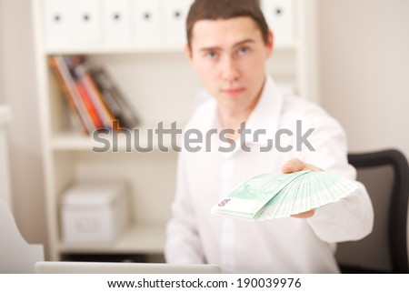 man holding euro money in office - stock photo