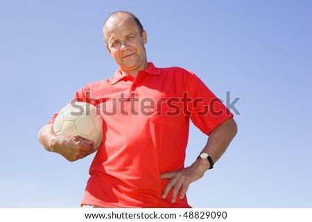 Man holding football - stock photo