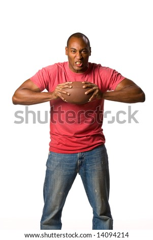 Man holding football with intense grip on ball and a ready to win expression. On-White - stock photo