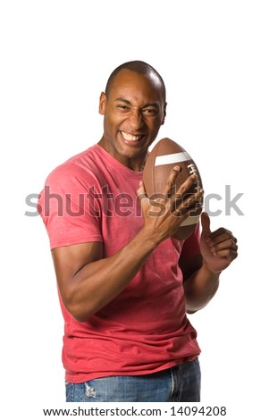 Man holding football with intense grip on ball and a victory smile facial expression. On-White - stock photo