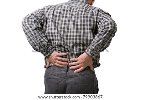 man holding hands to his aching back - stock photo