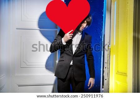 Man holding heart symbol - stock photo