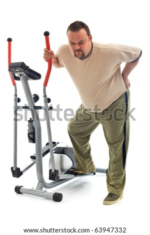 Man holding his aching back leaning on exercising device - isolated