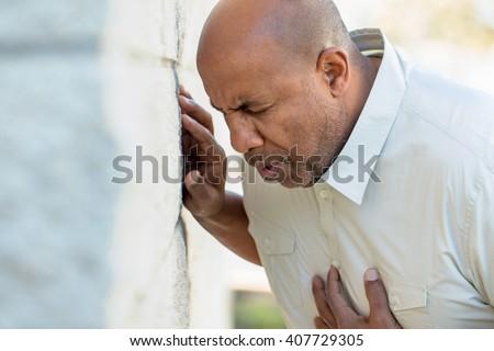 stock photo man holding his heart 407729305 man holding his heart stock photo (royalty free) 407729305