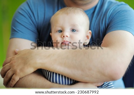 Man holding his little baby - stock photo