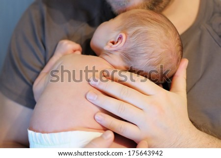 Man holding his sweet newborn baby - stock photo