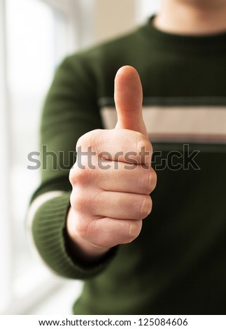 Man holding his thumb up, ok, super - stock photo
