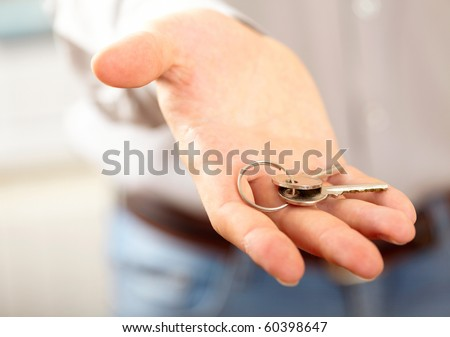 Man holding key. Shallow DOF, focus on key