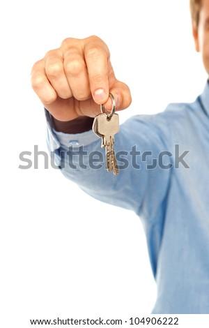 Man holding keys. Focus on keys - stock photo