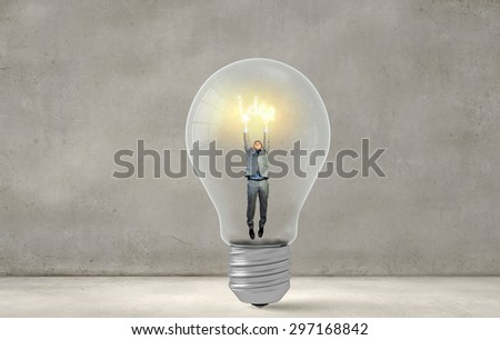 Man holding luminous idea inside light bulb - stock photo