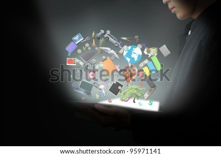 Man holding magic book - stock photo