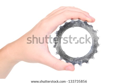 Man holding metallic cogwheel in his hand isolated on white - stock photo