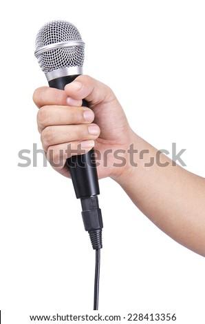 Man holding microphone - stock photo