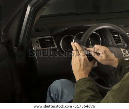 Man holding mobile phone in car/Vehicle Safety/Driver operating a cell  with car use