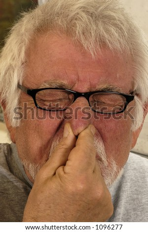 Man holding nose because of bad smell - stock photo