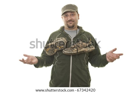 man holding old muddy shoes - stock photo
