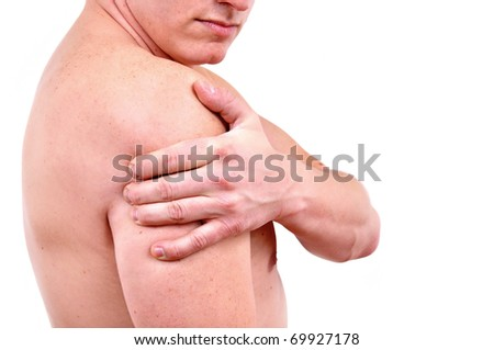 Man holding on arm - stock photo