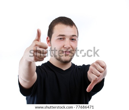 Man holding one thumb down and the other one up - stock photo