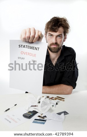 Man holding out unpaid statement to camera looking angry