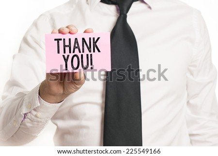 Man holding paper with thank you text isolated over white background - stock photo
