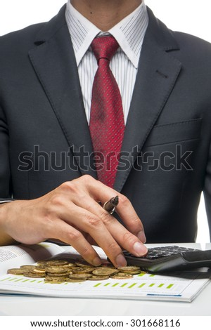 Man holding pen and calculator (Business Concept) - stock photo