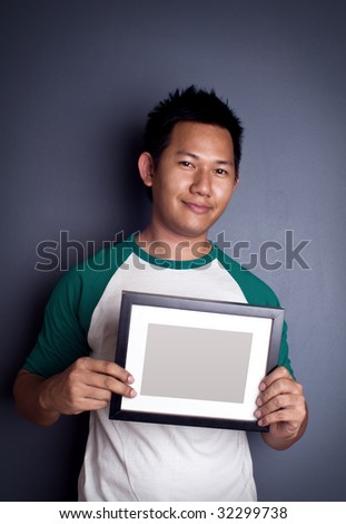 Man holding picture frame - stock photo