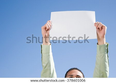 Man holding piece of paper