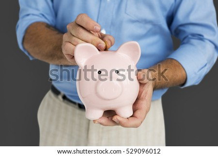 Man Holding Piggy Bank Saving Portrait Concept