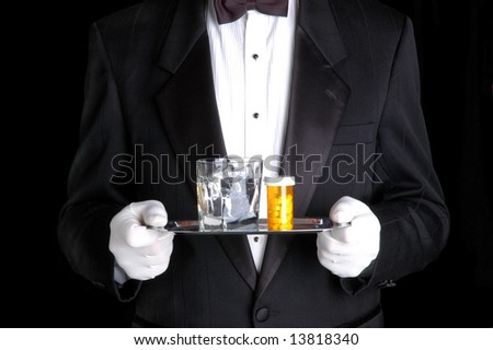 Man Holding Pills and Glass of Water on Silver Tray - stock photo