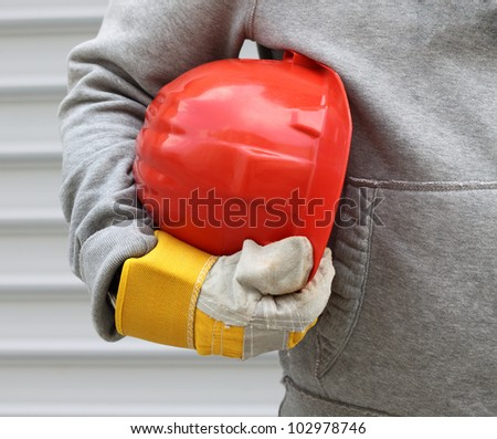 Man holding red helmet close up - stock photo